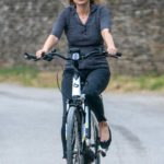 Kate Moss in a Gray Blouse Tests Her Electric Bike Near Her Home in Cotswold Hills