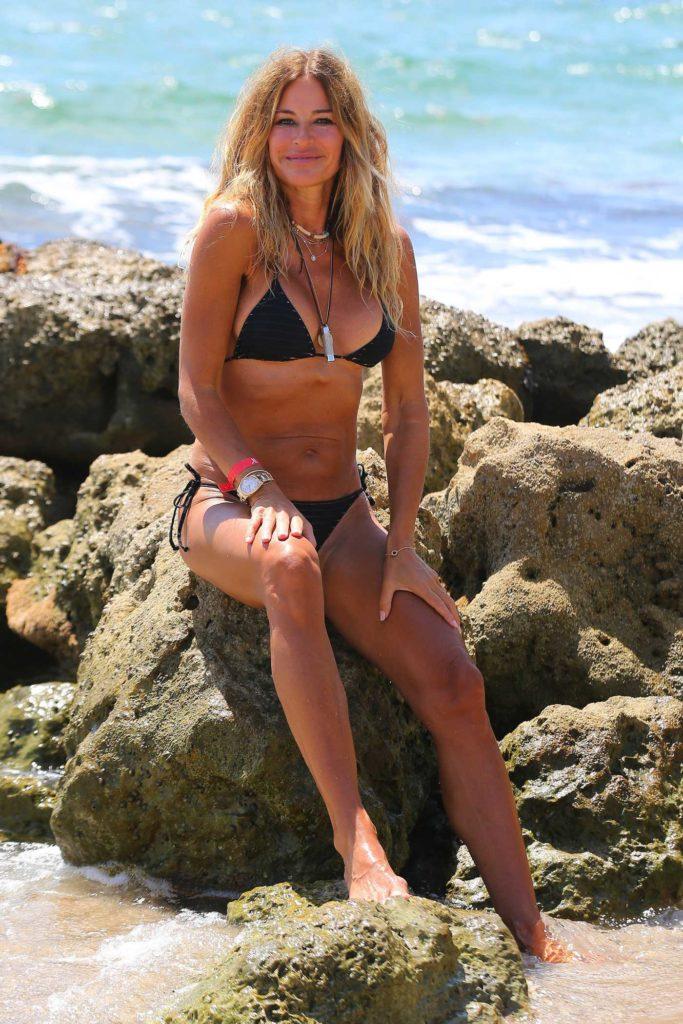 Kelly Bensimon in a Black Bikini