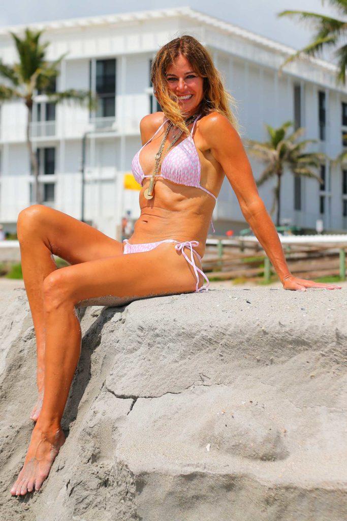 Kelly Bensimon in a Pink Bikini