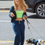 Maisie Smith in a Neon Green Top Walks Her Dogs in Essex