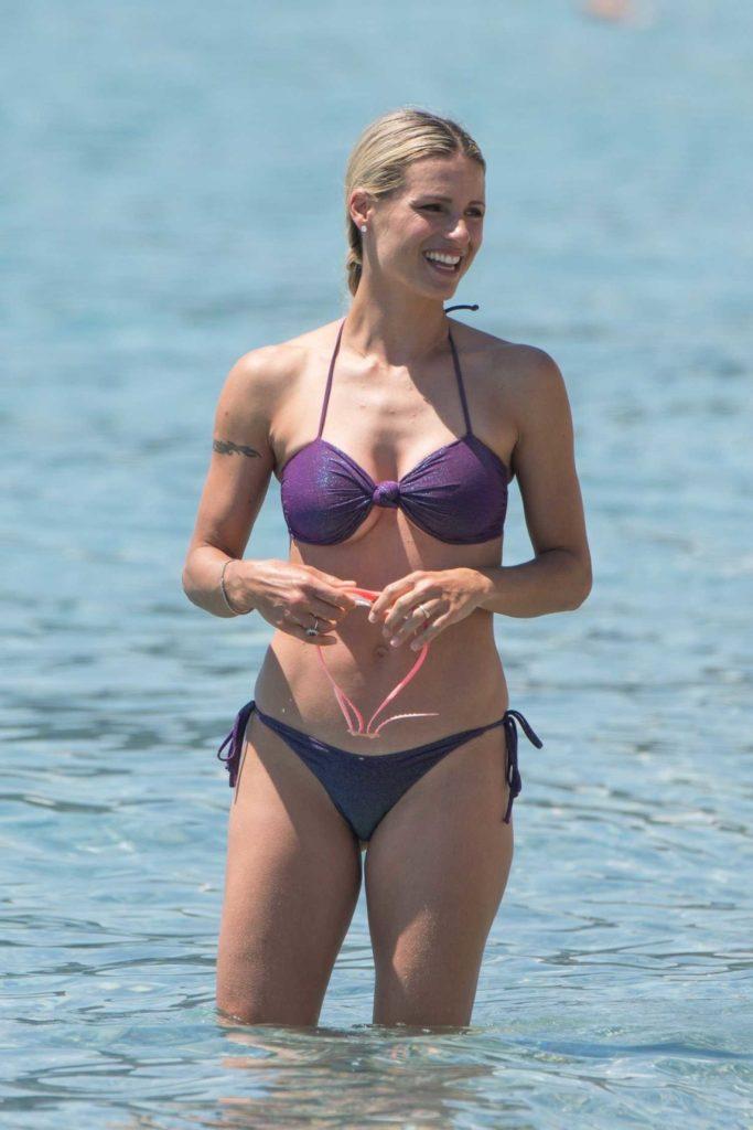 Michelle Hunziker in a Purple Bikini