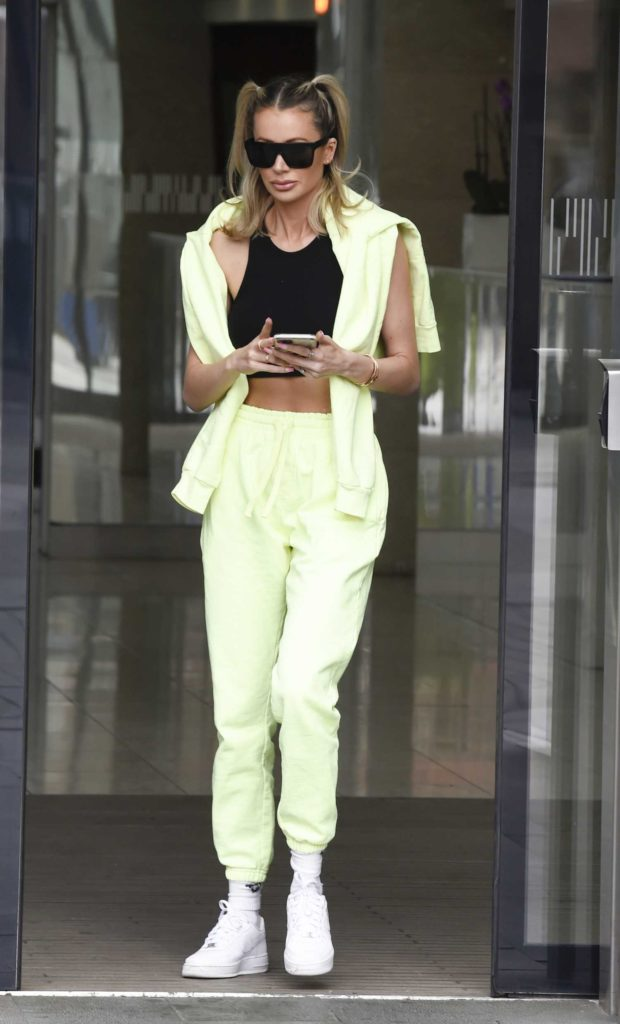 Olivia Attwood in a Fluorescent Green Tracksuit
