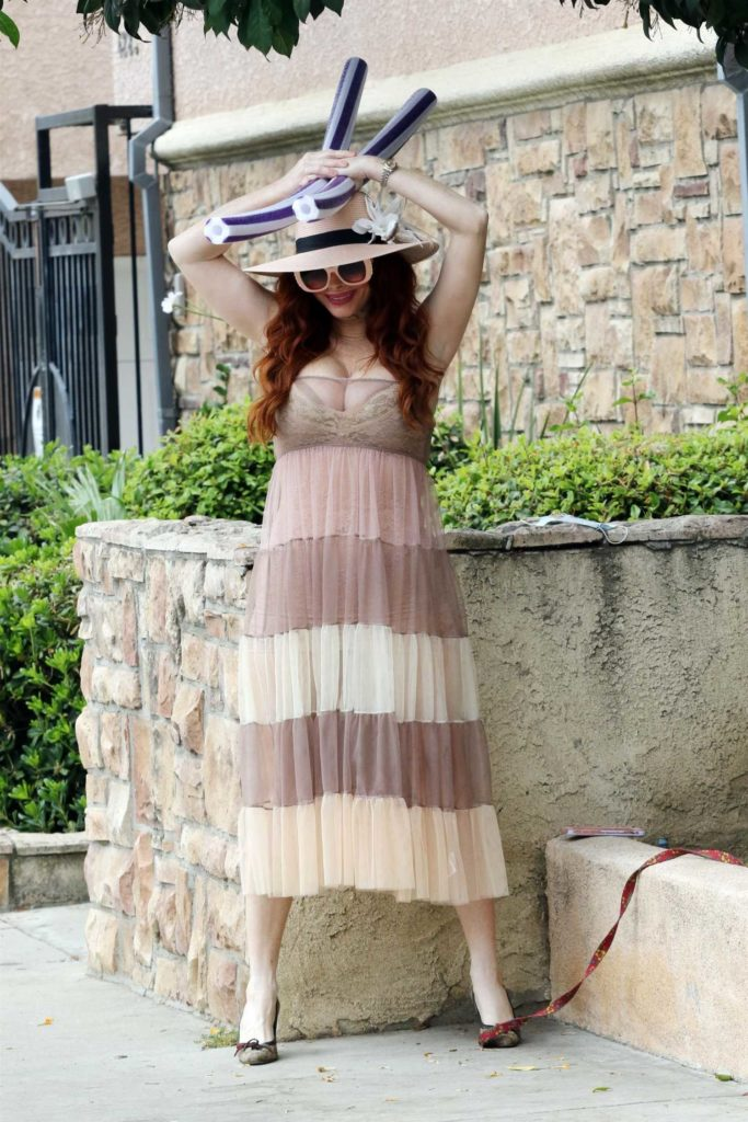 Phoebe Price in a Beige Dress