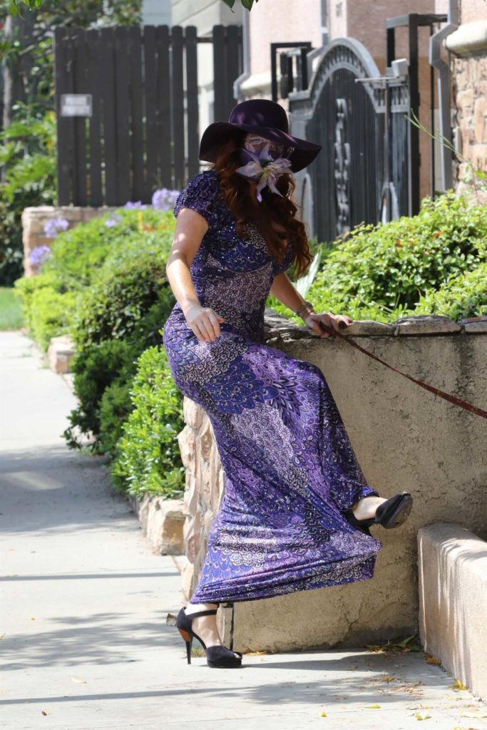 Phoebe Price in a Purple Dress