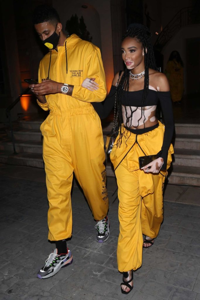 Winnie Harlow in a Yellow Jumpsuit