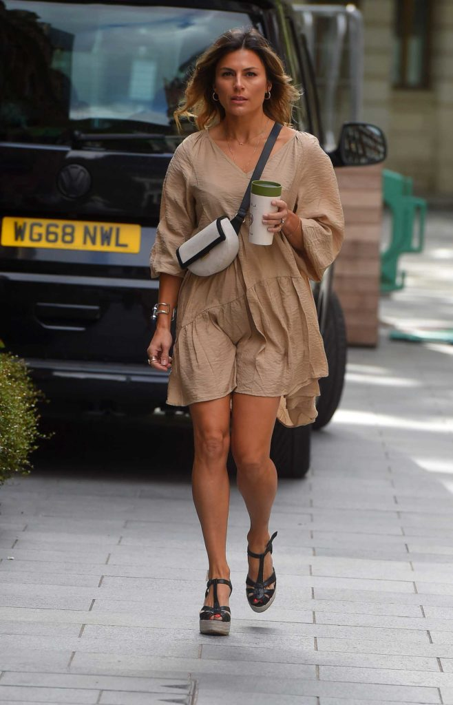 Zoe Hardman in a Beige Dress