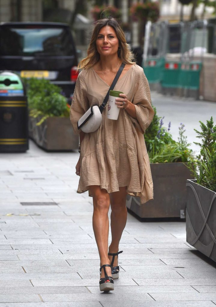 Zoe Hardman in a Beige Dress