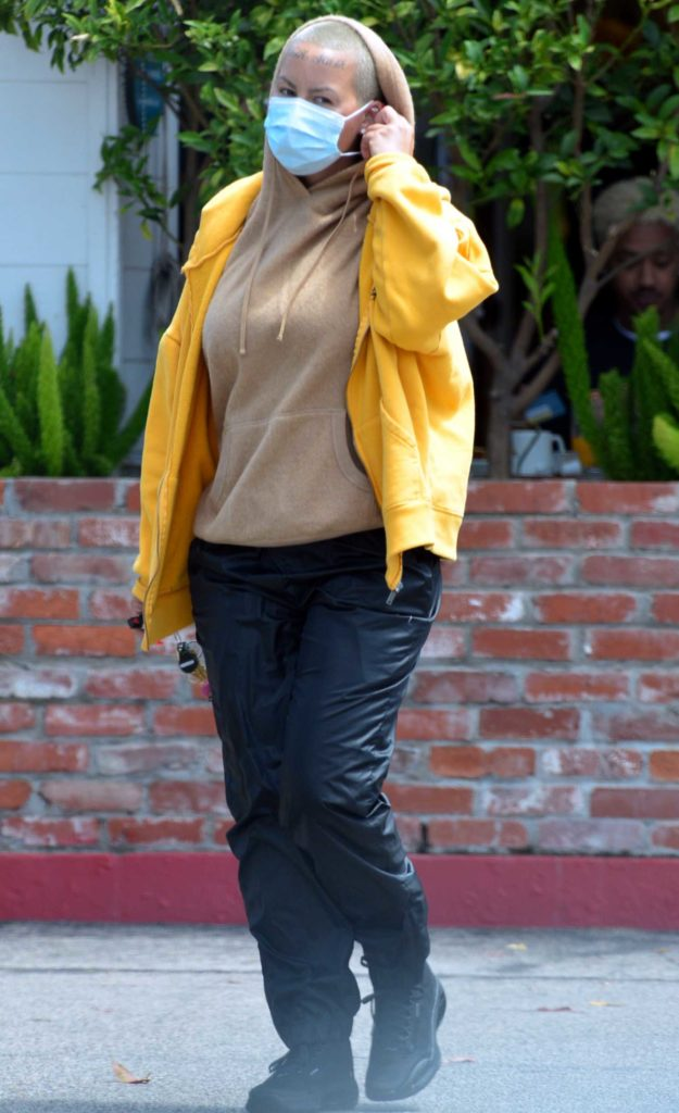 Amber Rose in a Yellow Track Jacket