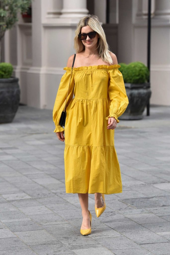 Ashley Roberts in a Yellow River Island Dress