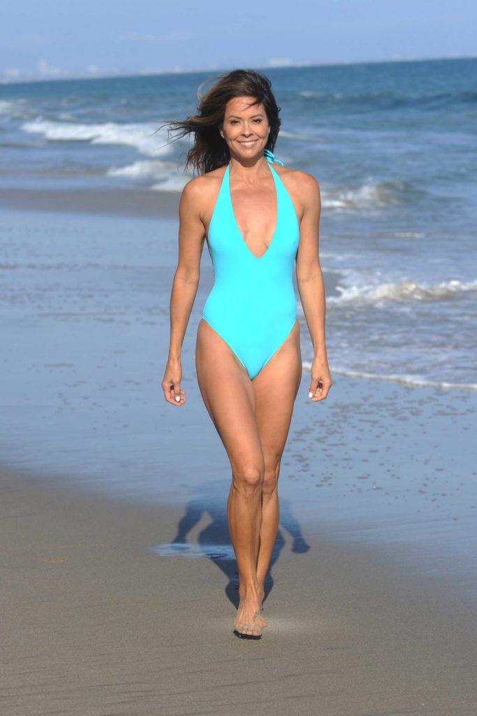 Brooke Burke in a Neon Blue Swimsuit