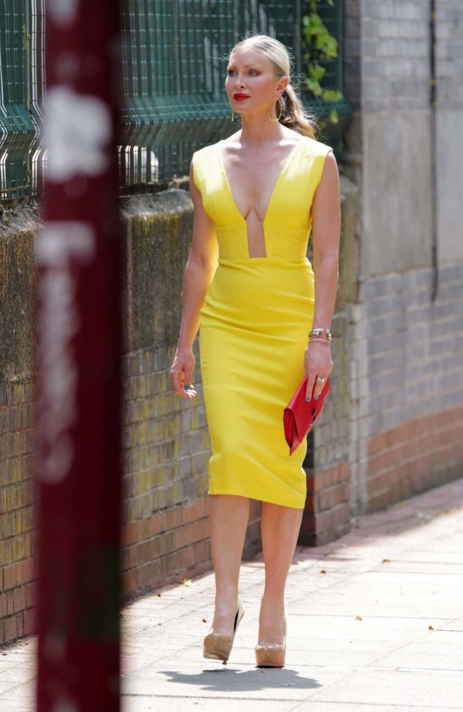 Caprice Bourret in a Yellow Dress