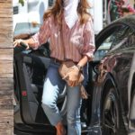 Cindy Crawford in a White Bandana as a Face Mask Arrives at Her Own Restaurant Cafe Habana in Malibu