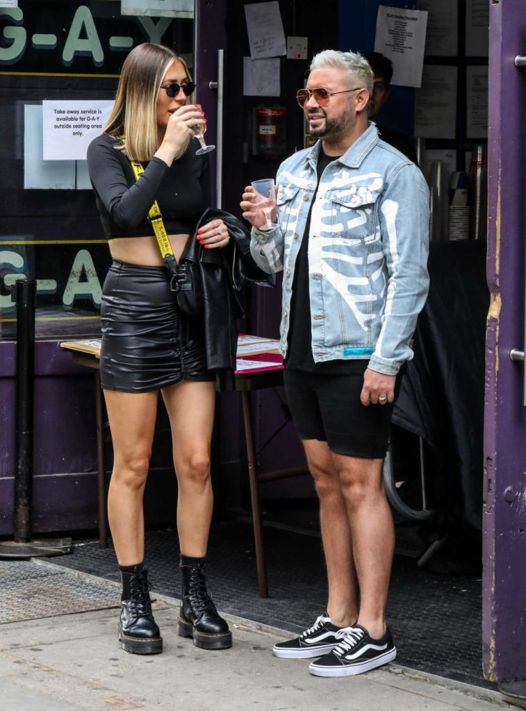 Demi Sims in a Short Black Skirt