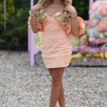 Ella Rae Wise in an Orange Mini Dress on the Set of The Only Way is Essex TV Show During the Food Festival in Chelmsford