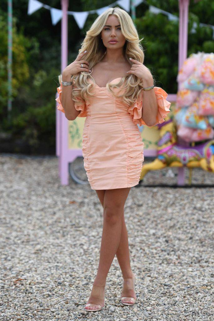Ella Rae Wise in an Orange Mini Dress