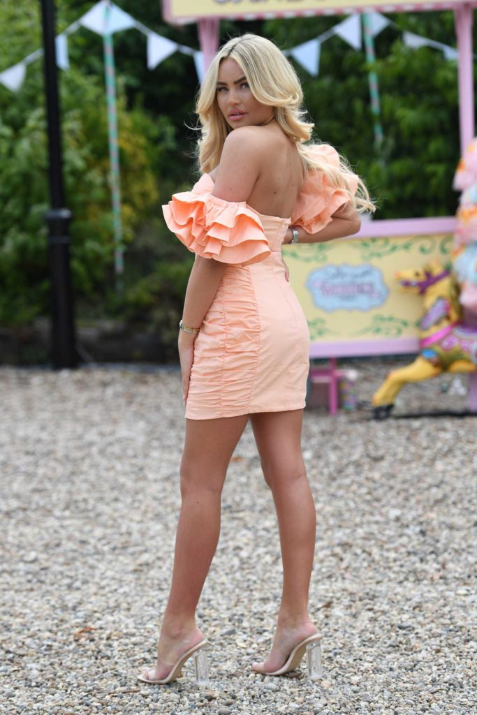 Ella Rae Wise in an Orange Mini Dress