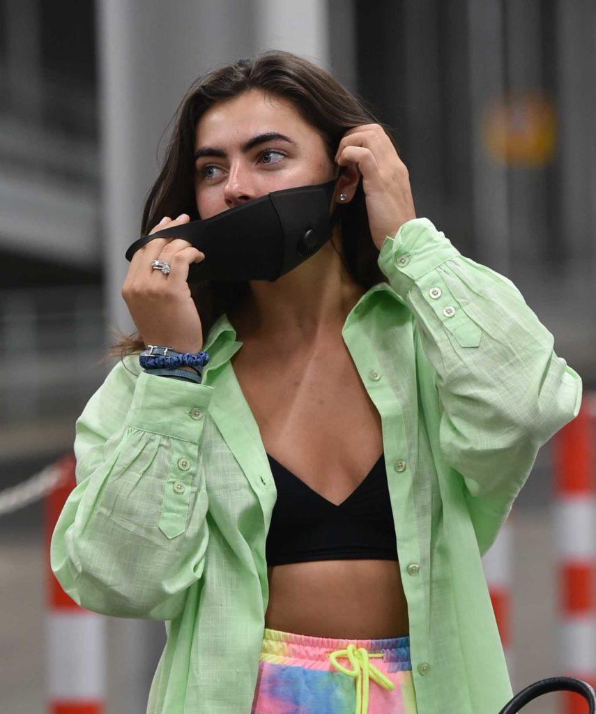 Francesca Allen in a Black Protective Mask