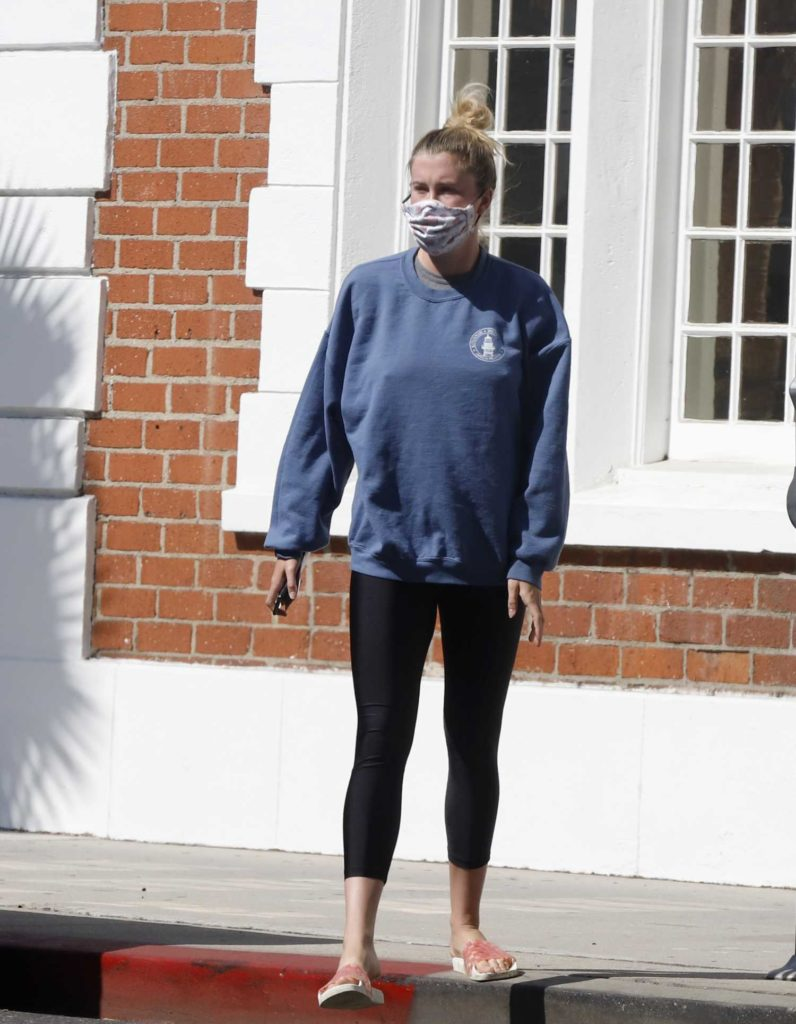 Ireland Baldwin in a Blue Sweatshirt