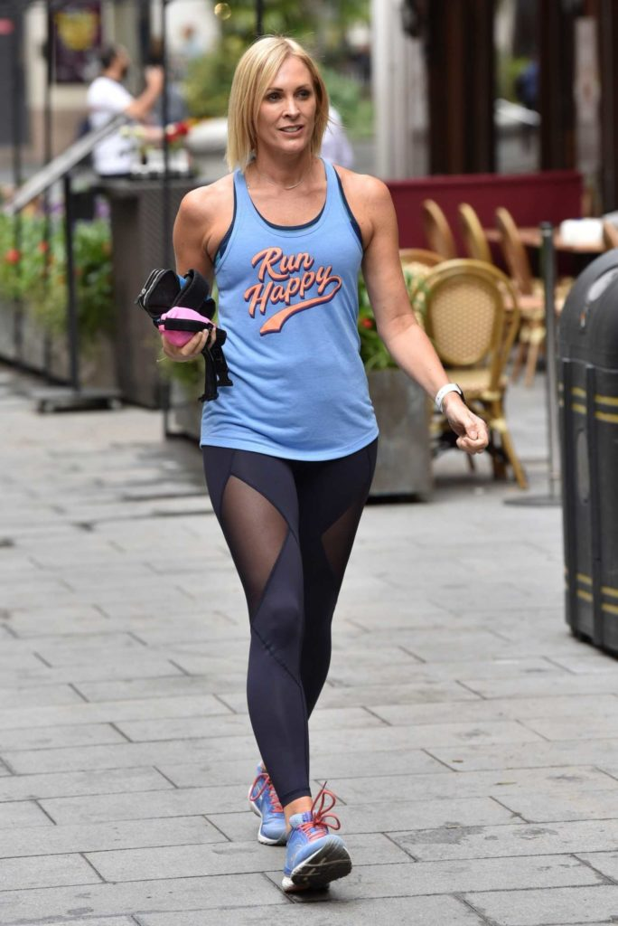 Jenni Falconer in a Blue Tank Top