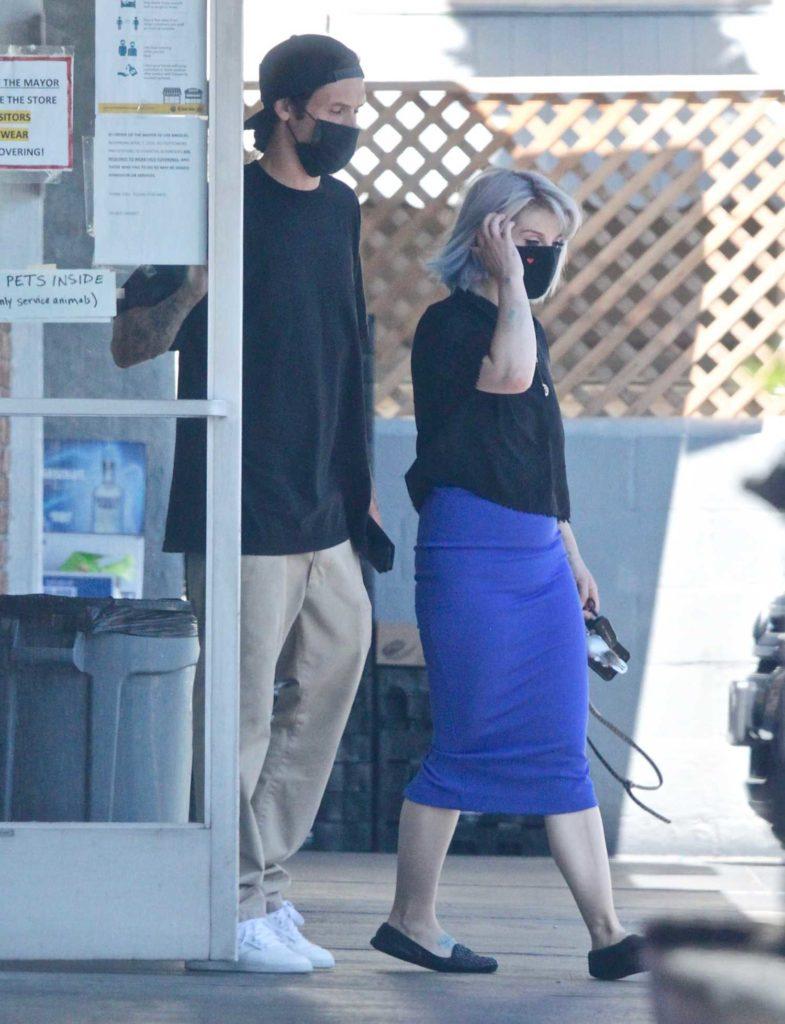 Kelly Osbourne in a Black Protective Mask