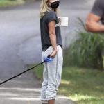 Kelly Ripa in a Black Tee Walks Her Dog Out with Her Husband Mark Consuelos in The Hamptons, New York