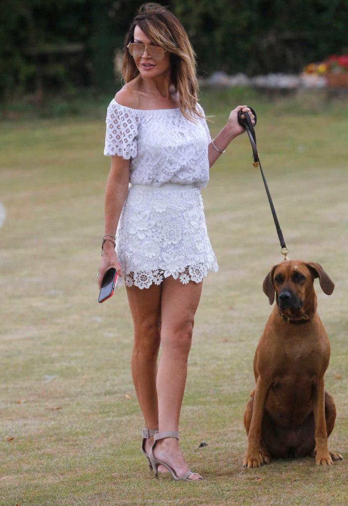 Lizzie Cundy in a White Dress