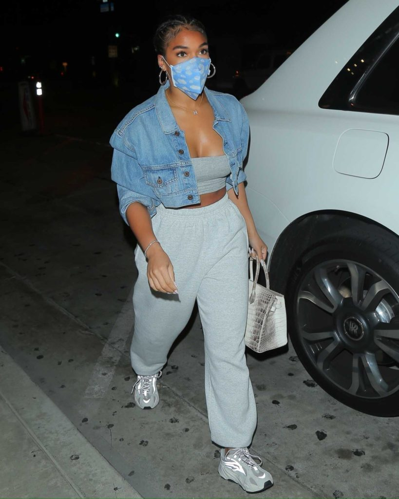 Lori Harvey in a Protective Mask
