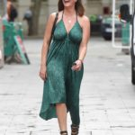 Lucy Horobin in a Green Animal Print Dress Arrives at the Global Studios in London