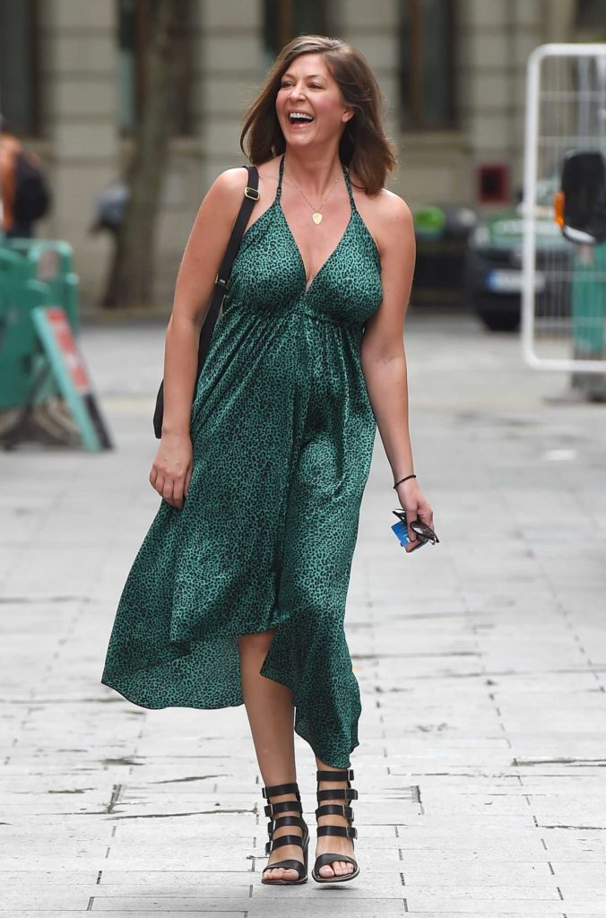 Lucy Horobin in a Green Animal Print Dress