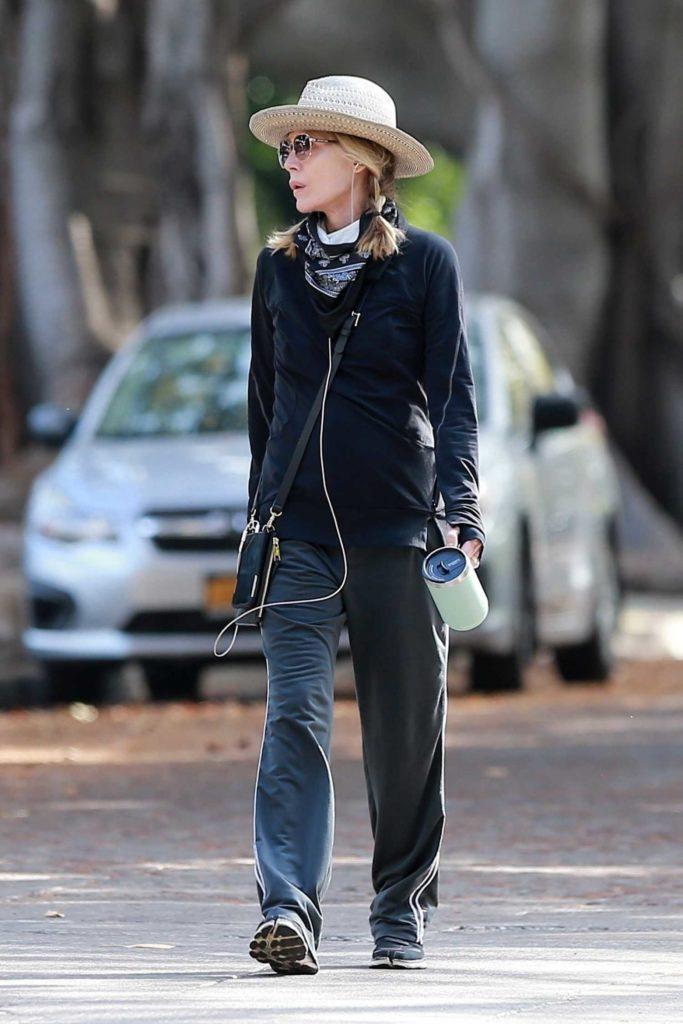 Michelle Pfeiffer in a Beige Hat