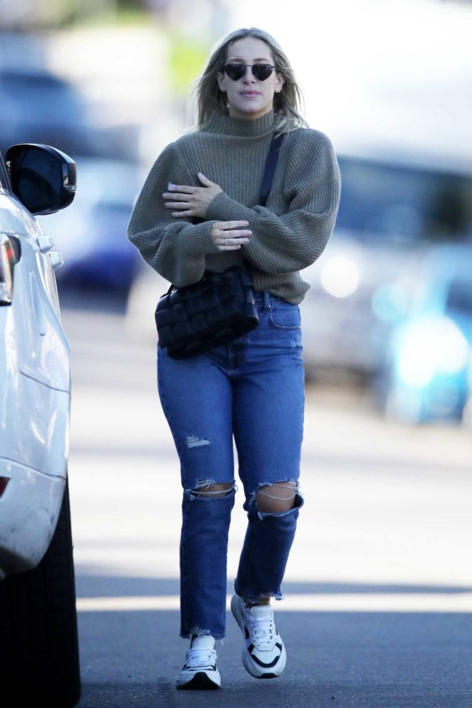 Phoebe Burgess in a Blue Ripped Jeans