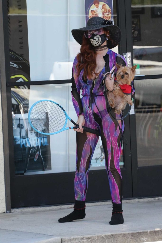 Phoebe Price in a Purple Skintight Playsuit