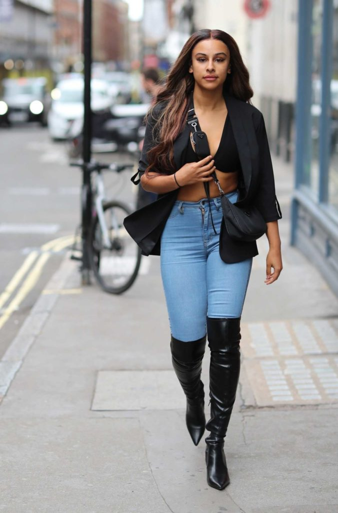 Shari Halliday in a Black Knee High Boots