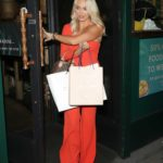 Amber Turner in a Red Jumpsuit Leaves Laki Kane Cocktail Bar in Islington, London