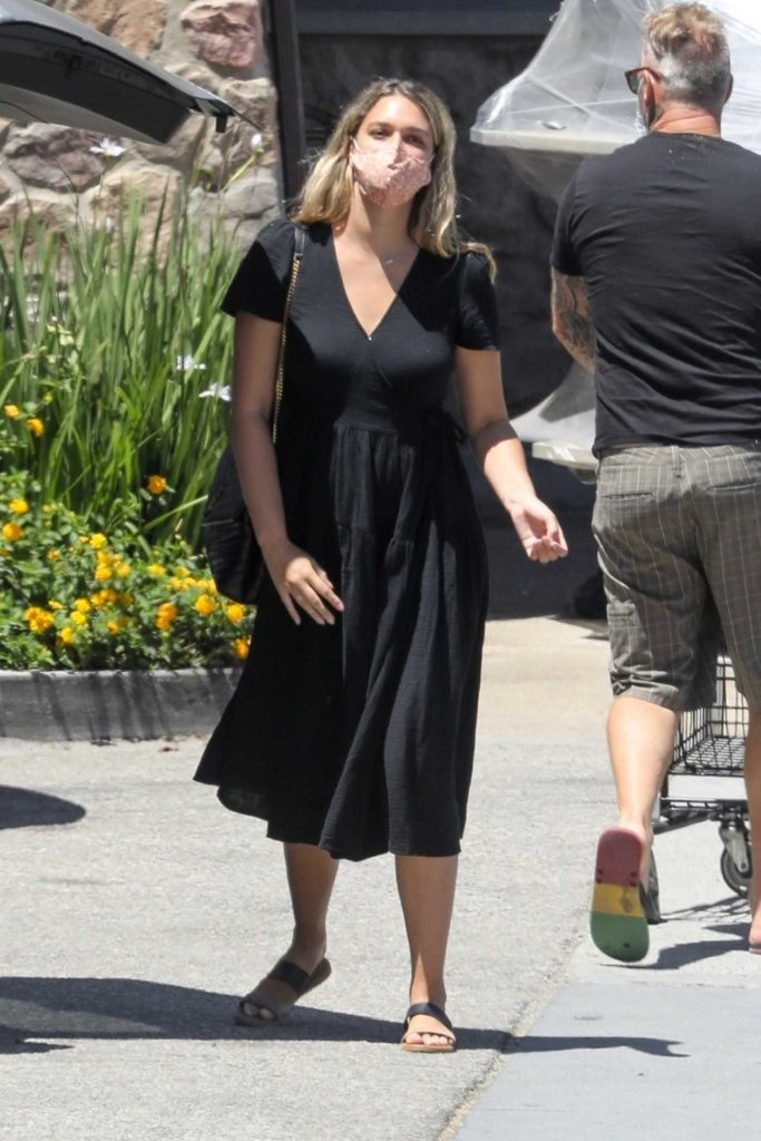 April Love Geary in a Black Dress