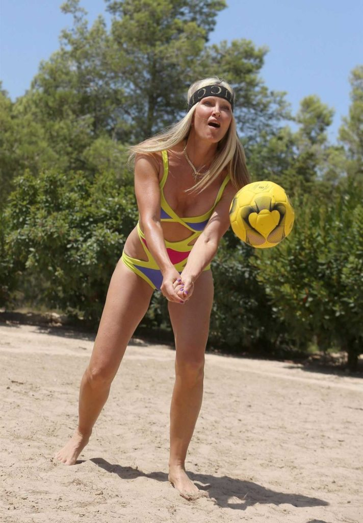 Caprice Bourret in a a Full Colour Swimsuit
