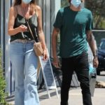 Cindy Crawford in an Olive Top Goes Shopping at a Local Optical Store in Malibu