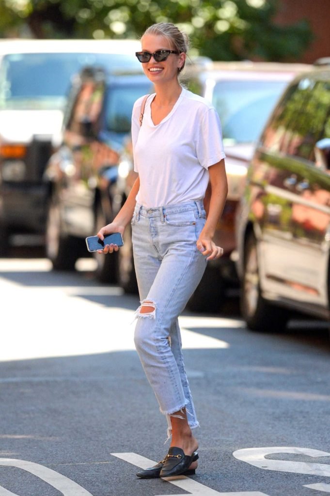 Daphne Groeneveld in a Blue Ripped Jeans