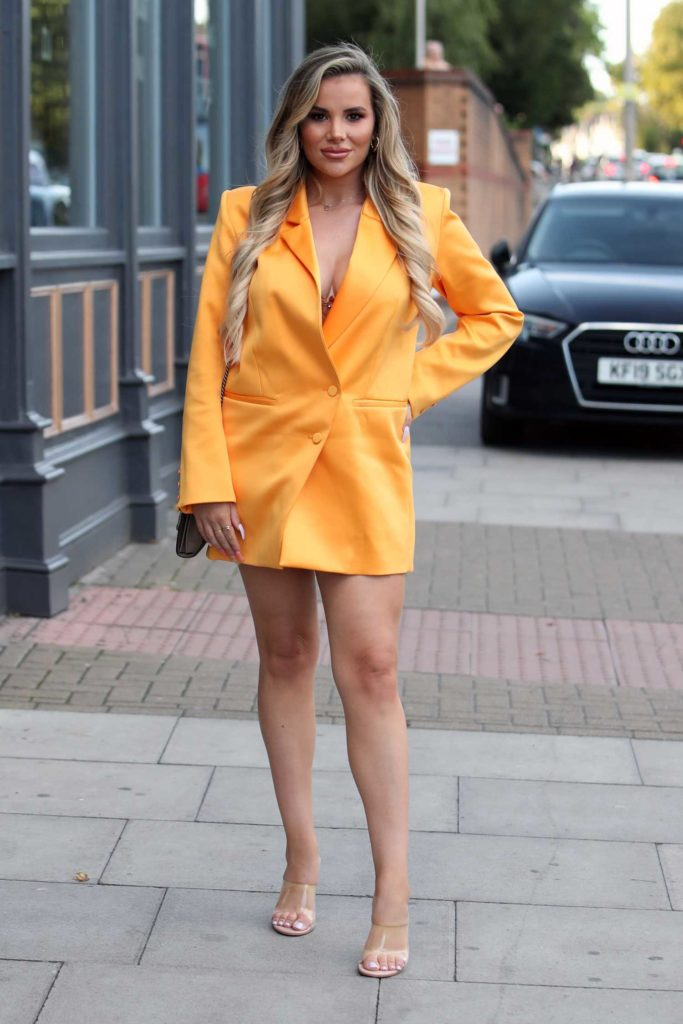 Georgia Kousoulou in a Yellow Blazer