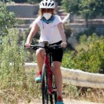 Isla Fisher in a White Tee Does Her Routine Bike Ride Around Los Angeles