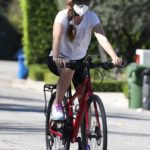 Isla Fisher in a White Tee Does Her Routine Bike Ride in Los Angeles