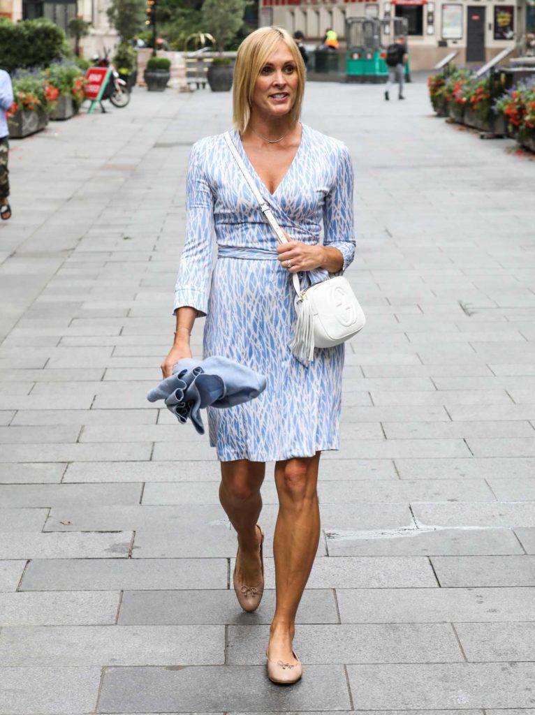 Jenni Falconer in a Blue Dress