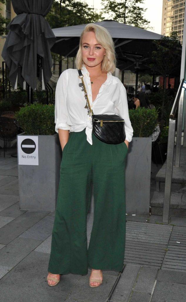 Jorgie Porter in a Green Pants
