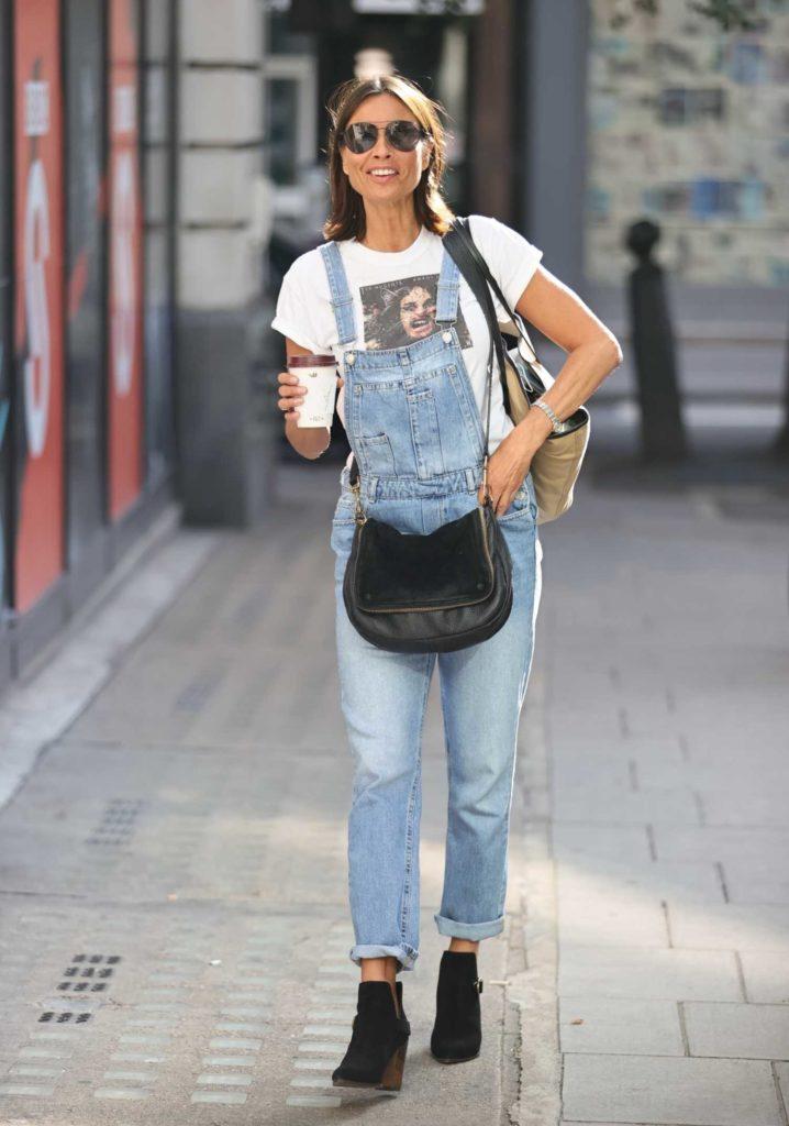 Melanie Sykes in a Blue Denim Jumpsuit