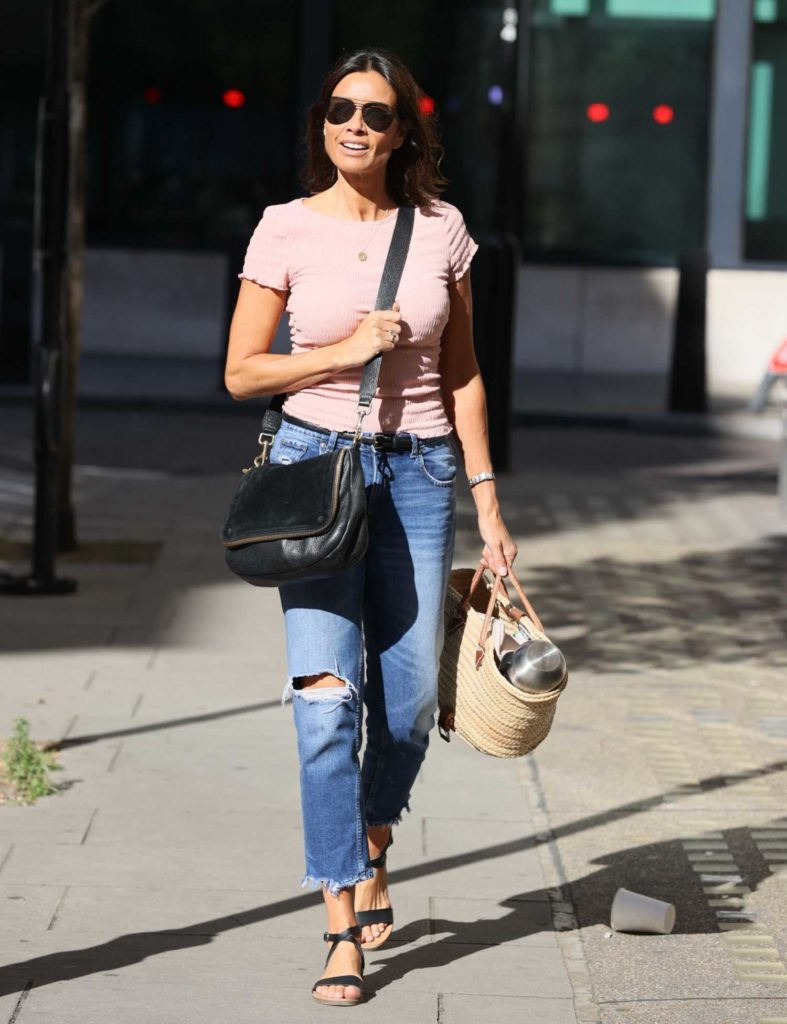 Melanie Sykes in a Pink Blouse