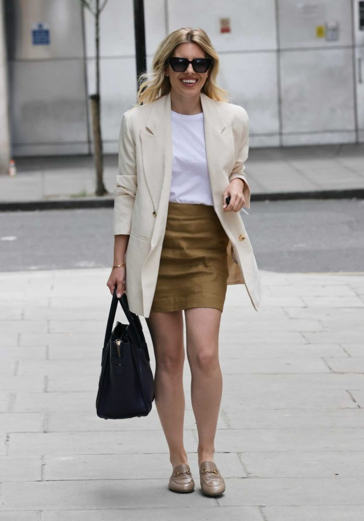 Mollie King in a Cream Blazer