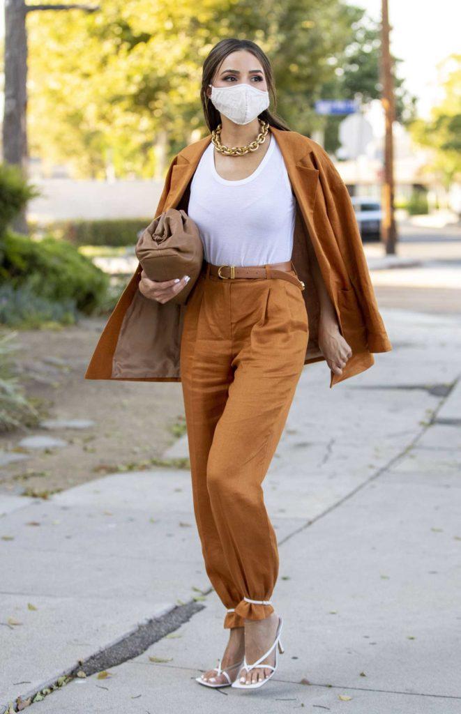 Olivia Culpo in a Tan Suit