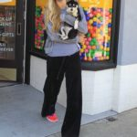 Paris Hilton in a Red Sneakers Goes Shopping Out with Her Puppy in Hollywood