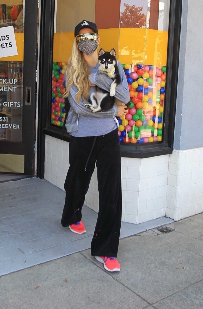 Paris Hilton in a Red Sneakers