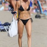 Rebecca Gormley in a Black Bikini on the Beach in Marbella